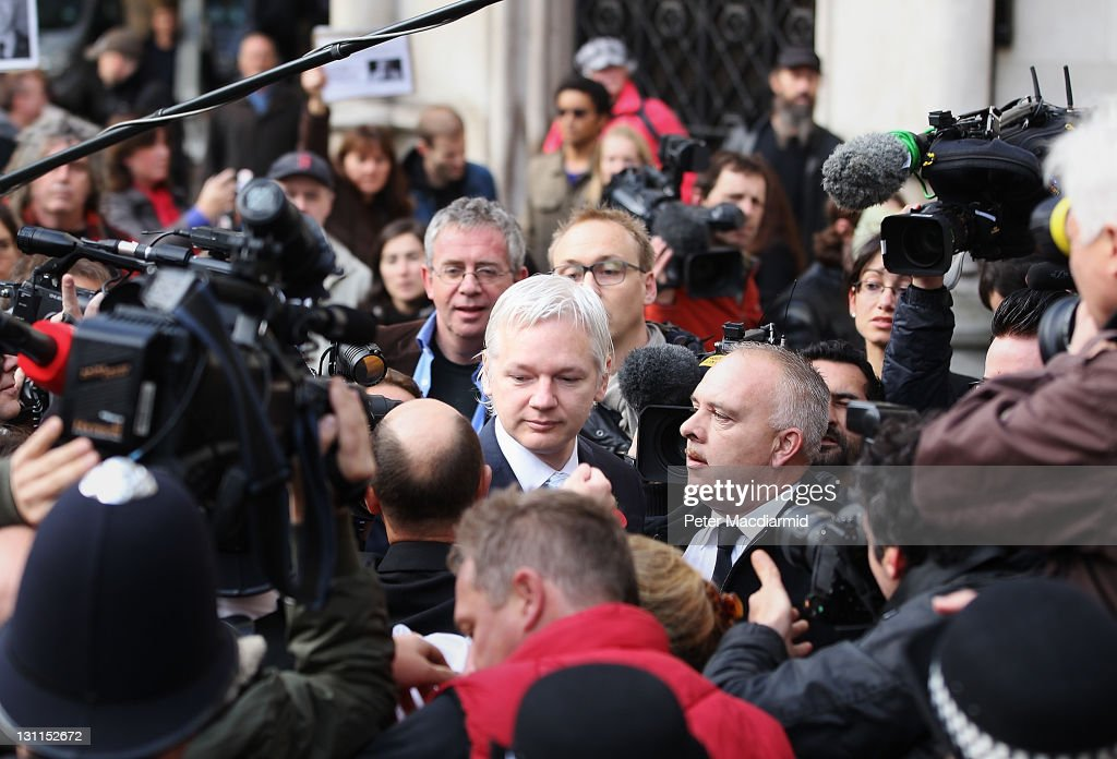 WikiLeaks founder <a gi-track='captionPersonalityLinkClicked' href=/galleries/search?phrase=Julian+Assange&family=editorial&specificpeople=7117000 ng-click='$event.stopPropagation()'>Julian Assange</a> (C) arrives at The High Court on November 2, 2011 in London, England. Mr Assange is appearing in court today to discover the outcome of his appeal against extradition to Sweden to face sexual assault allegations.