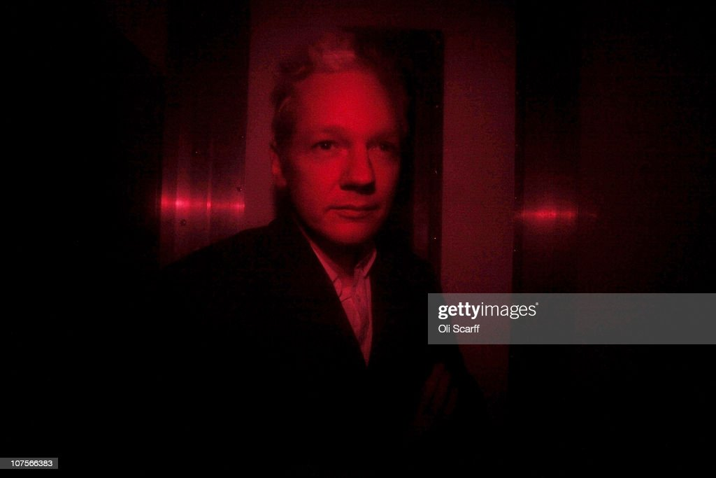 Wikileaks founder <a gi-track='captionPersonalityLinkClicked' href=/galleries/search?phrase=Julian+Assange&family=editorial&specificpeople=7117000 ng-click='$event.stopPropagation()'>Julian Assange</a> arrives at Westminster Magistrates Court inside a prison van with red windows on December 14, 2010 in London, England. Mr Assange is expected to seek bail during his extradition hearings.