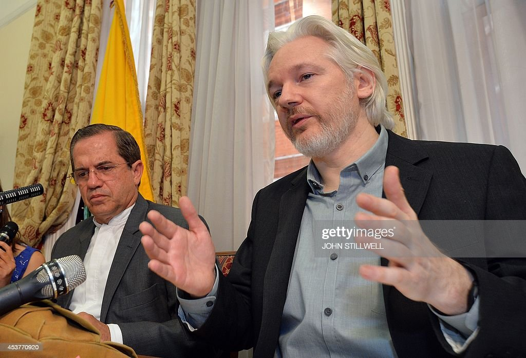 WikiLeaks founder Julian Assange (R) gestures as he speaks next to Ecuador's Foreign Minister Ricardo Patino (L) during a press conference inside the Ecuadorian Embassy in London on August 18, 2014 where Assange has been holed up for two years. WikiLeaks founder Julian Assange said Monday he would 'soon' leave Ecuador's embassy in London but his organisation played down the comment, saying he would not depart until there was an agreement with Britain's government. Assange took refuge in June 2012 in the Ecadorian Embassy to avoid extradition to Sweden, where he faces allegations of rape and sexual molestation, which he strongly denies.