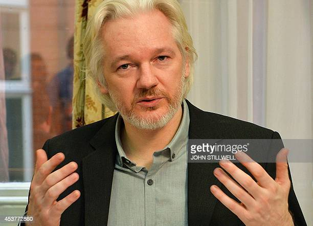 WikiLeaks founder Julian Assange gestures during a press conference inside the Ecuadorian Embassy in London on August 18 2014 where Assange has been...