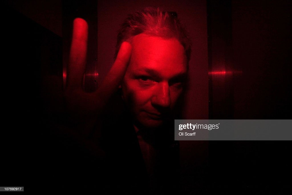 Wikileaks founder <a gi-track='captionPersonalityLinkClicked' href=/galleries/search?phrase=Julian+Assange&family=editorial&specificpeople=7117000 ng-click='$event.stopPropagation()'>Julian Assange</a> gestures inside a prison van with red windows as he leaves Westminster Magistrates Court on December 14, 2010 in London, England. Assange has been granted conditional bail, however he will remain in police custody for the next 48 hours as Swedish prosecutors appeal the decision.