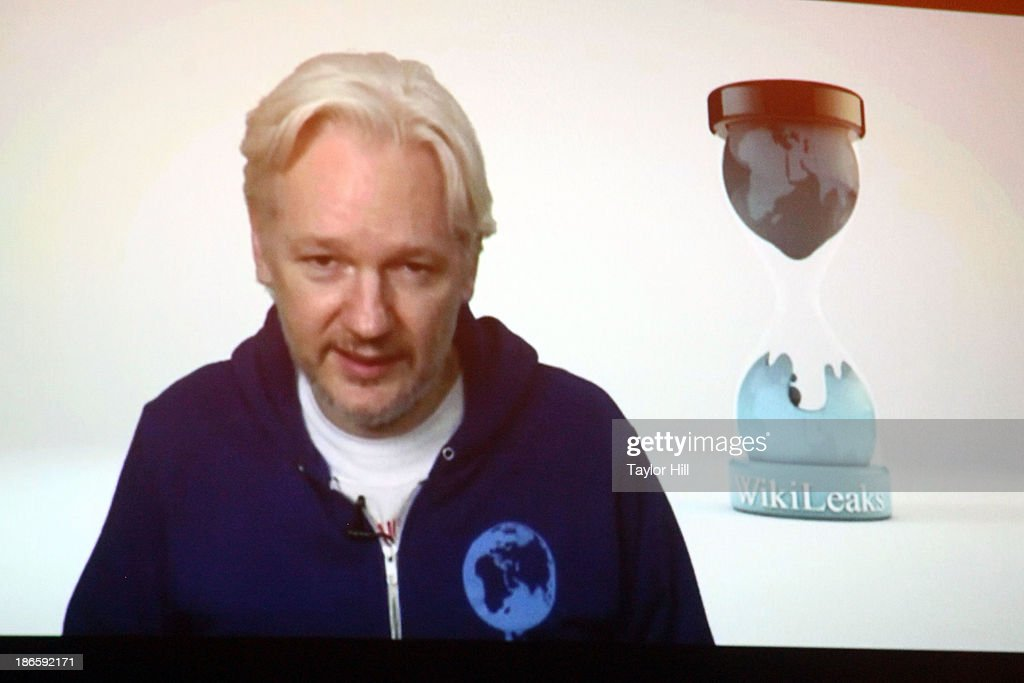 Wikileaks founder <a gi-track='captionPersonalityLinkClicked' href=/galleries/search?phrase=Julian+Assange&family=editorial&specificpeople=7117000 ng-click='$event.stopPropagation()'>Julian Assange</a> introduces M.I.A. via videolink from the Ecuadorian embassy in London at Terminal 5 on November 1, 2013 in New York City.