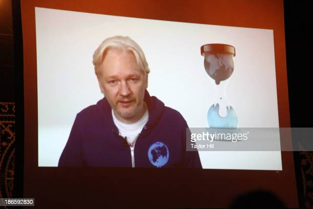 Wikileaks founder Julian Assange introduces MIA via videolink from the Ecuadorian embassy in London at Terminal 5 on November 1 2013 in New York City