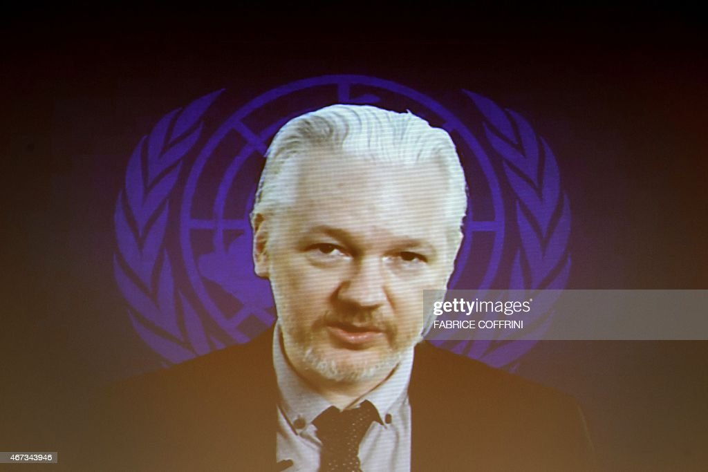 WikiLeaks founder <a gi-track='captionPersonalityLinkClicked' href=/galleries/search?phrase=Julian+Assange&family=editorial&specificpeople=7117000 ng-click='$event.stopPropagation()'>Julian Assange</a> is seen on a screen speaking via web cast from the Ecuadorian Embassy in London during an event on the sideline of the United Nations (UN) Human Rights Council session on March 23, 2015 in Geneva. Assange took refuge in June 2012 in the Ecuadorian Embassy to avoid extradition to Sweden, where he faces allegations of rape and sexual molestation, which he strongly denies.