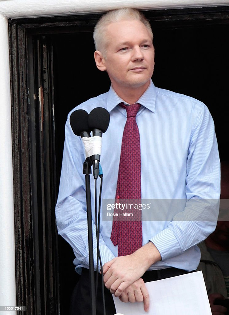 Wikileaks founder <a gi-track='captionPersonalityLinkClicked' href=/galleries/search?phrase=Julian+Assange&family=editorial&specificpeople=7117000 ng-click='$event.stopPropagation()'>Julian Assange</a> is seen on the balcony of the Equador embassy in Knightsbridge on August 19, 2012 in London, England. Mr Assange is currently living inside Ecuador's London embassy after being granted political asylum whilst facing extradition to Sweden to face allegations of sexual assault. It has been suggested by Ecuador's president Rafael Correa that Mr Assange may co-operate with Sweden if they promised that he would not be extradited to a third country.