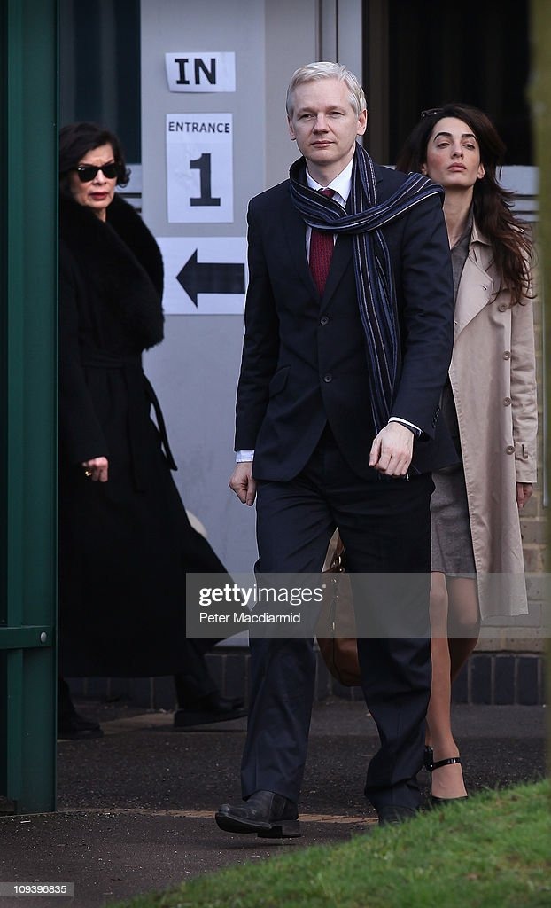 Wikileaks founder Julian Assange leaves Belmarsh Magistrates Court with a member of his legal team and supporter Bianca Jagger (L) on February 24, 2011 in London, England. Mr Assange faces being extradited to Sweden, to face charges on grounds of an alleged sexual assault against two women, after a judge decided that the European arrest warrant (EAW) issued by Sweden is valid and didn't breach Mr Assange's human rights. Mark Stephens, the lawyer representing the WikiLeaks founder has said Mr Assange will appeal against the ruling. .