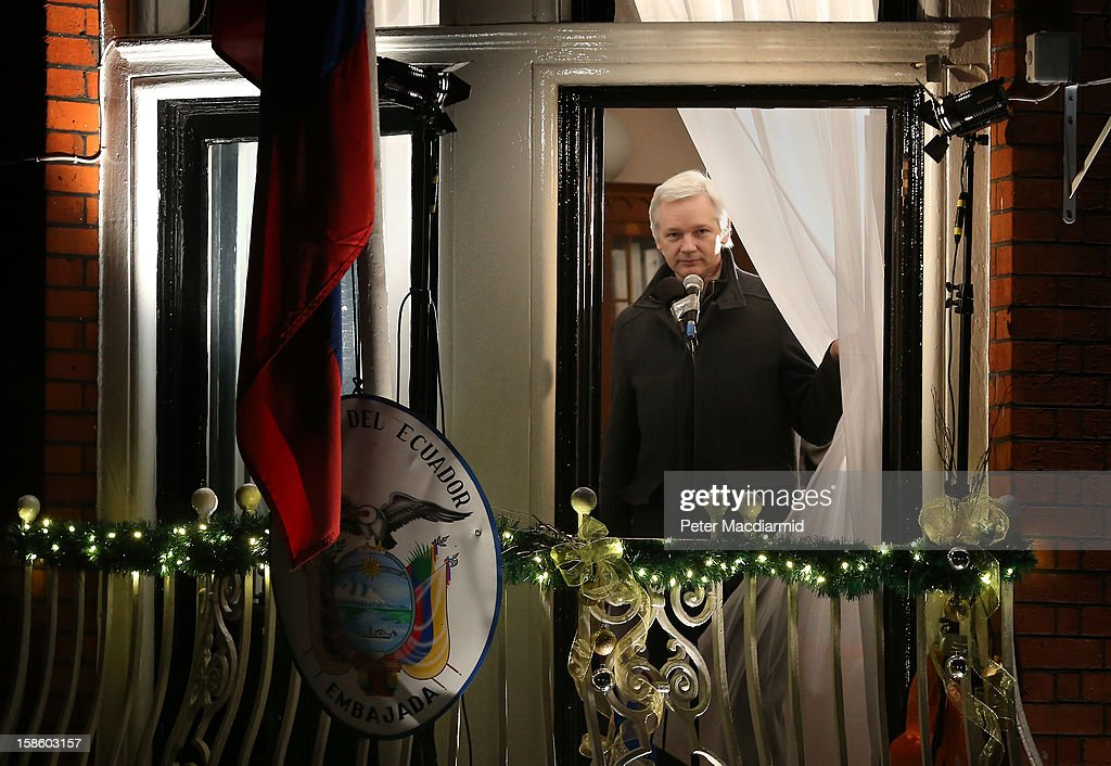 Wikileaks founder <a gi-track='captionPersonalityLinkClicked' href=/galleries/search?phrase=Julian+Assange&family=editorial&specificpeople=7117000 ng-click='$event.stopPropagation()'>Julian Assange</a> parts the curtains as he starts to speak from a balcony at the Ecuadorian Embassy on December 20, 2012 in London, England. Mr Assange has been living in the embassy since June 2012 in an attempt to avoid extradition to Sweden where he faces allegations of sexual assault.