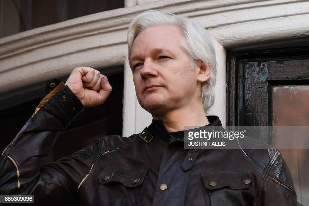 TOPSHOT Wikileaks founder Julian Assange raises his fist prior to addressing the media on the balcony of the Embassy of Ecuador in London on May 19...