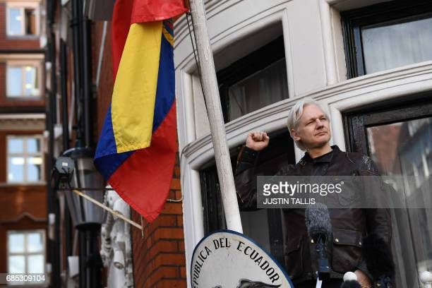 Wikileaks founder Julian Assange raises his fist prior to addressing the media on the balcony of the Embassy of Ecuador in London on May 19 2017...