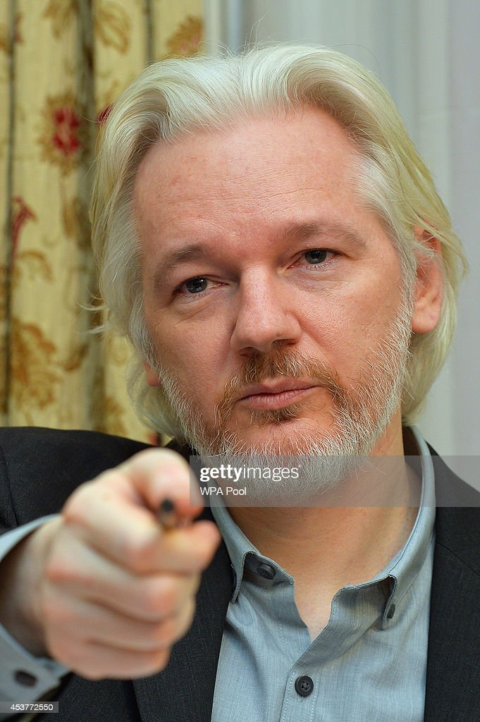 WikiLeaks founder <a gi-track='captionPersonalityLinkClicked' href=/galleries/search?phrase=Julian+Assange&family=editorial&specificpeople=7117000 ng-click='$event.stopPropagation()'>Julian Assange</a> reacts during a press conference, where he confirmed he 'will be leaving the embassy soon', in the Ecuadorian Embassy on August 18, 2014 in London, England. Mr Assange has been living in the embassy since June 2012 in an attempt to avoid extradition to Sweden where he faces allegations of sexual assault.