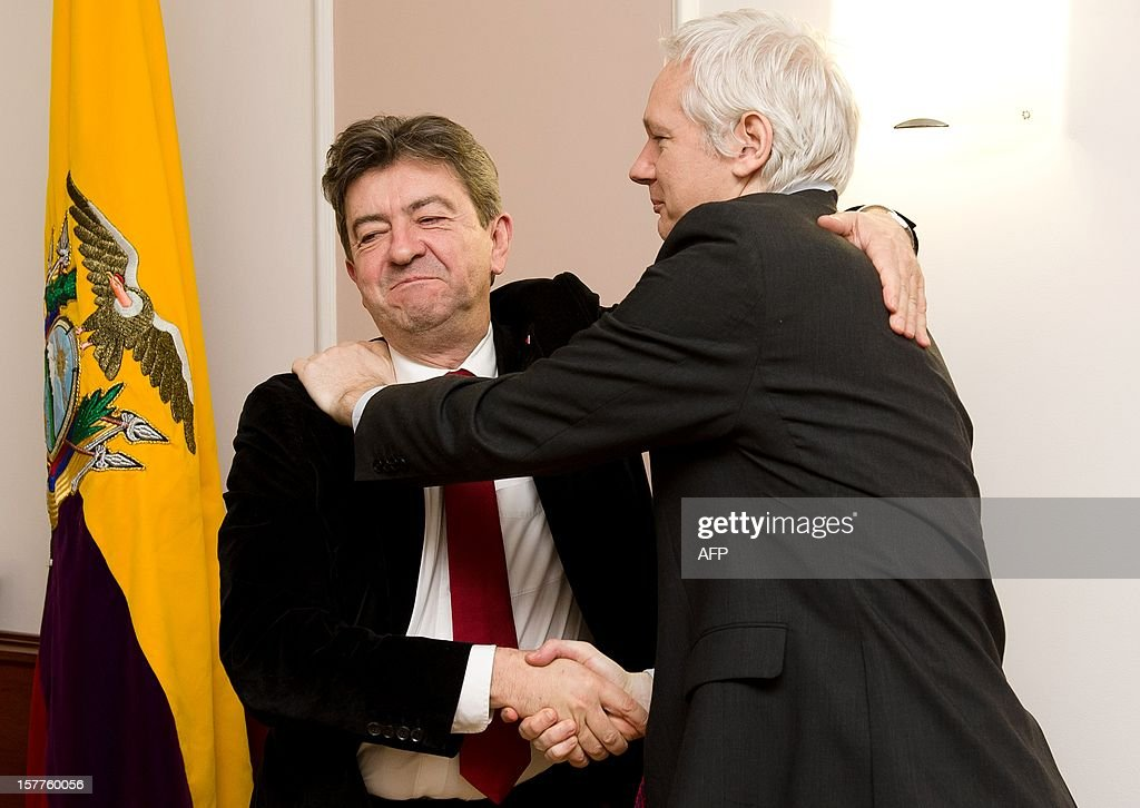 Wikileaks founder Julian Assange (R) shakes hands with French politician Jean Luc Melenchon as Ecuadorian Ambassador Ana Amlma (L) looks on inside the Ecuadorian embassy in central London, on December 6, 2012. AFP PHOTO/Leon Neal
