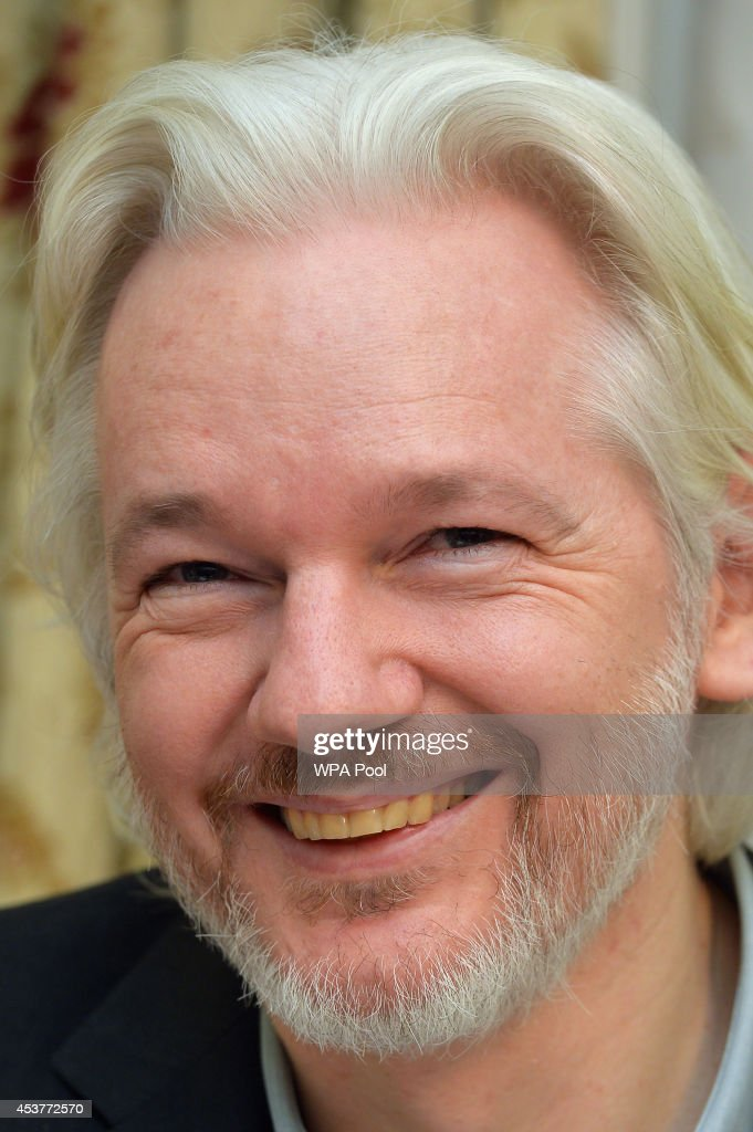 WikiLeaks founder <a gi-track='captionPersonalityLinkClicked' href=/galleries/search?phrase=Julian+Assange&family=editorial&specificpeople=7117000 ng-click='$event.stopPropagation()'>Julian Assange</a> smiles during a press conference, where he confirmed he 'will be leaving the embassy soon', in the Ecuadorian Embassy on August 18, 2014 in London, England. Mr Assange has been living in the embassy since June 2012 in an attempt to avoid extradition to Sweden where he faces allegations of sexual assault.