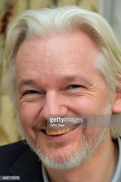 WikiLeaks founder Julian Assange smiles during a press conference where he confirmed he 'will be leaving the embassy soon' in the Ecuadorian Embassy...