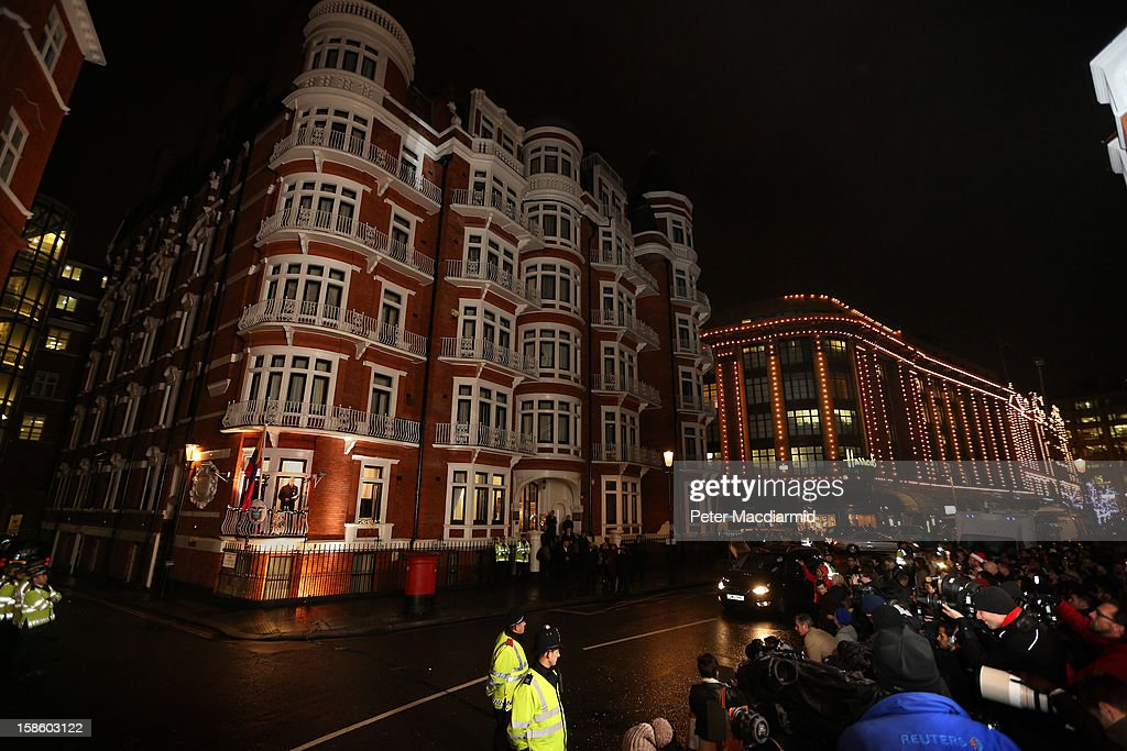Wikileaks founder Julian Assange (lower left) speaks from the Ecuadorian Embassy balcony in sight of Harrods department store on December 20, 2012 in London, England. Mr Assange has been living in the embassy since June 2012 in an attempt to avoid extradition to Sweden where he faces allegations of sexual assault.