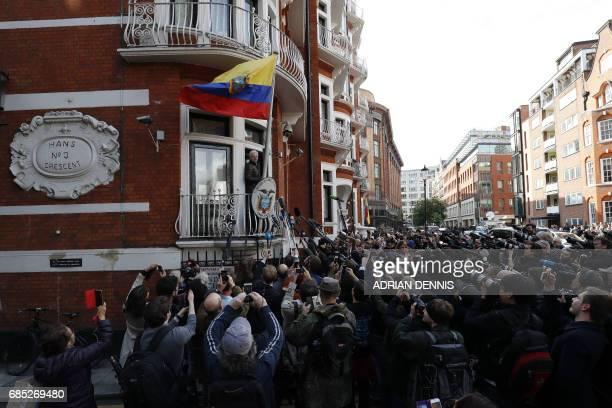 TOPSHOT Wikileaks founder Julian Assange speaks on the balcony of the Embassy of Ecuador in London on May 19 2017 Ecuador urged Britain today to...