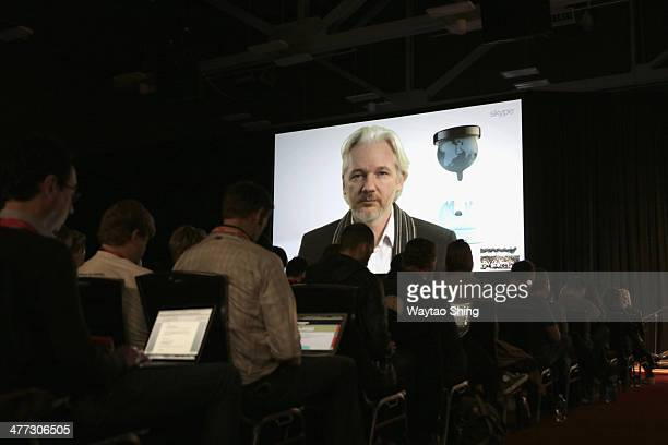 Wikileaks founder Julian Assange speaks onstage via Skype at 'A Virtual Conversation with Julian Assange' during the 2014 SXSW Music Film Interactive...