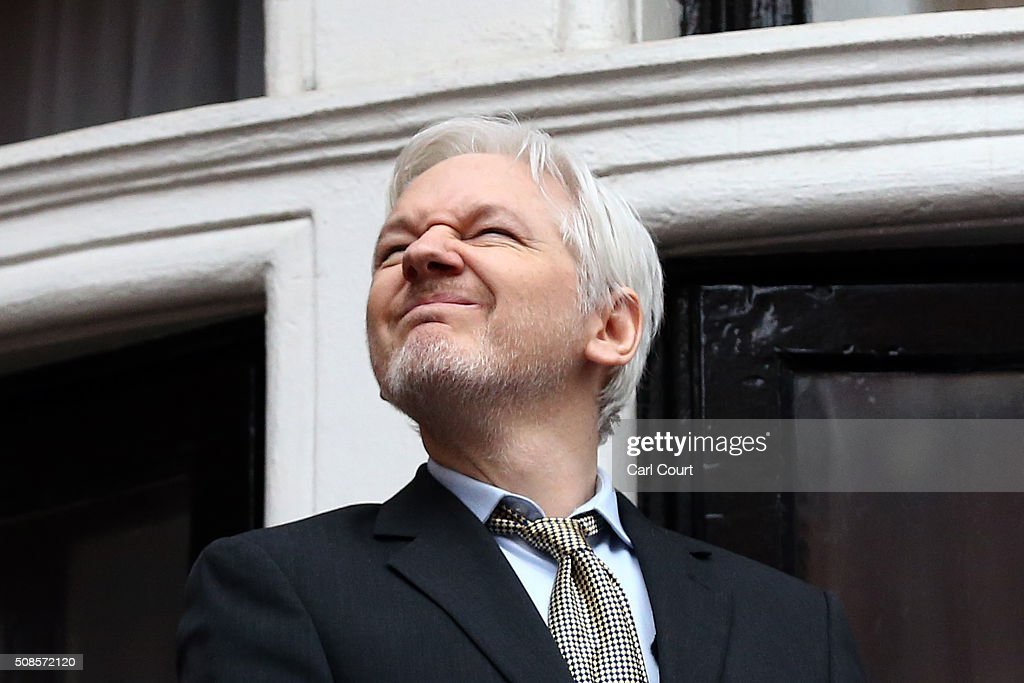 Wikileaks founder <a gi-track='captionPersonalityLinkClicked' href=/galleries/search?phrase=Julian+Assange&family=editorial&specificpeople=7117000 ng-click='$event.stopPropagation()'>Julian Assange</a> squints in the sunlight as he prepares to speak from the balcony of the Ecuadorian embassy where he continues to seek asylum following an extradition request from Sweden in 2012, on February 5, 2016 in London, England. The United Nations Working Group on Arbitrary Detention has insisted that Mr Assange's detention should be brought to an end.