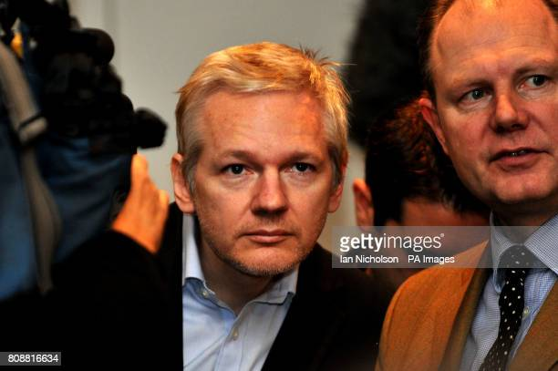 WikiLeaks founder Julian Assange stands amongst the media at the Frontline Club in London prior to accepting two CDs from former Swiss banker and...