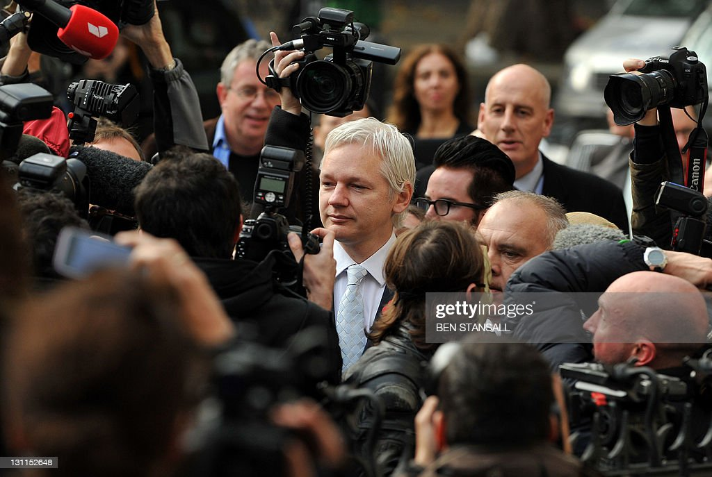 WikiLeaks founder Julian Assange (C) walks through a mass of media personnel as he arrives at London's High Court on November 2, 2011. Julian Assange finds out on Wednesday whether he will be forced to leave Britain in order to face questioning over rape allegations in Sweden. The High Court in London is set to announce at 0945 GMT whether the 40-year-old Australian, whose whistleblowing website has enraged governments around the world, should be extradited following his arrest in December.