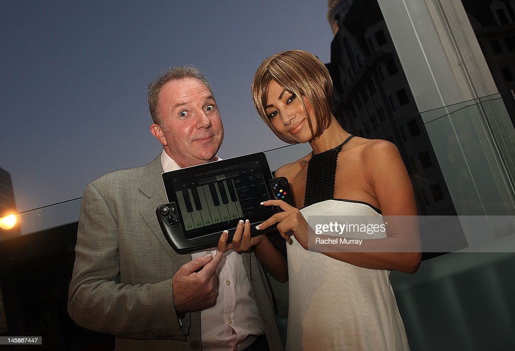 WikiPad President of Sales, Fraser Townley (L) and actress <a gi-track='captionPersonalityLinkClicked' href=/galleries/search?phrase=Bai+Ling&family=editorial&specificpeople=201459 ng-click='$event.stopPropagation()'>Bai Ling</a> attend the VIP red carpet cocktail party hosted by WIKIPAD and NVIDIA as part of the celebrations for E3, 2012 held at Elevate Lounge on June 6, 2012 in Los Angeles, California.