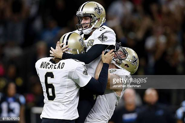 Wil Lutz of the New Orleans Saints celebrates after kicking the game winning field goal during the second half of a game against the Carolina...
