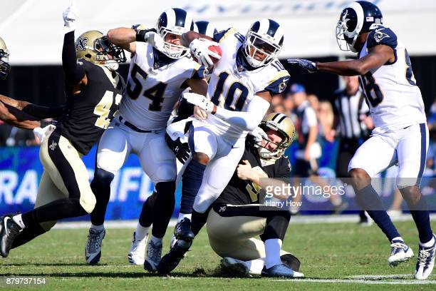 Wil Lutz of the New Orleans Saints tackles Pharoh Cooper of the Los Angeles Rams on the opening kickoff during the first quarter of the game at the...
