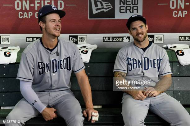 Wil Myers and Matt Szczur of the San Diego Padres sit in the dugout prior to the game against the Arizona Diamondbacks at Chase Field on September 10...