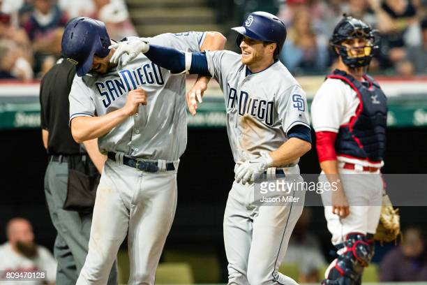 Wil Myers of the San Diego Padres celebrates with Cory Spangenberg after both scored on a home run by Spangenberg during the seventh inning against...