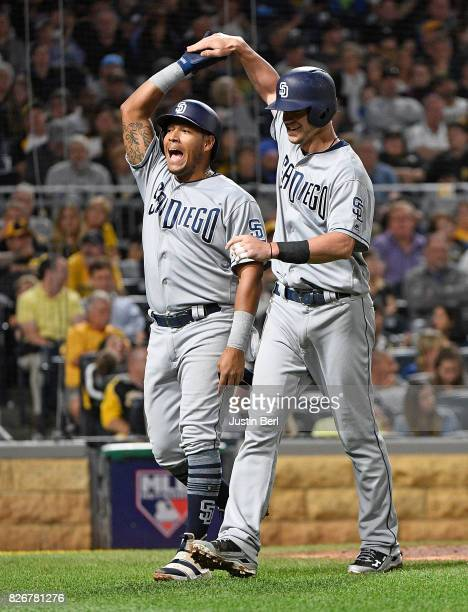 Wil Myers of the San Diego Padres celebrates with Yangervis Solarte after hitting a two run home run in the fifth inning during the game against the...
