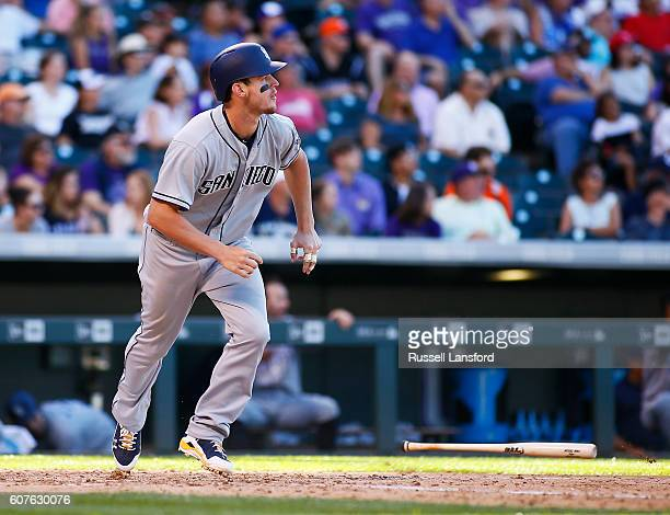Wil Myers of the San Diego Padres connects for a two RBI double in the top of the sixth inning of a regular season MLB game between the Colorado...