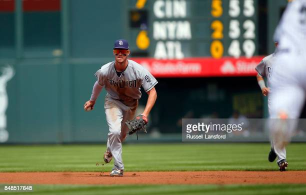 Wil Myers of the San Diego Padres fields a ball during the first inning of a regular season MLB game between the Colorado Rockies and the visiting...