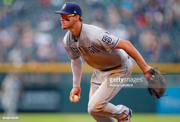 Wil Myers of the San Diego Padres fields a ground ball during a regular season MLB game between the Colorado Rockies and the visiting San Diego...