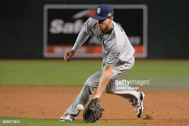 Wil Myers of the San Diego Padres fields a ground ball in the second inning against the Arizona Diamondbacks at Chase Field on September 10 2017 in...