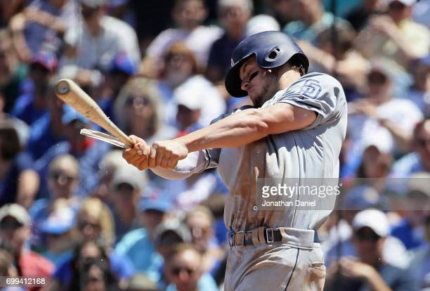 Wil Myers of the San Diego Padres hits a broken bat single in the 3rd inning against the Chicago Cubs at Wrigley Field on June 21 2017 in Chicago...
