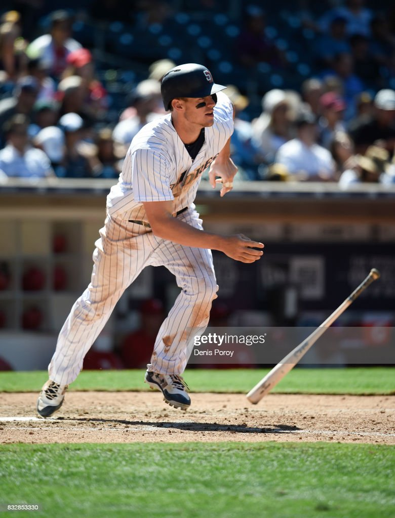 Wil Myers #4 of the San Diego Padres hits a double during the eighth inning of a baseball game against the Philadelphia Phillies at PETCO Park on August 16, 2017 in San Diego, California.