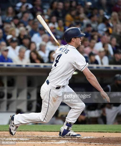 Wil Myers of the San Diego Padres hits a single during the third inning of a baseball game against the Colorado Rockies at PETCO Park on September 23...