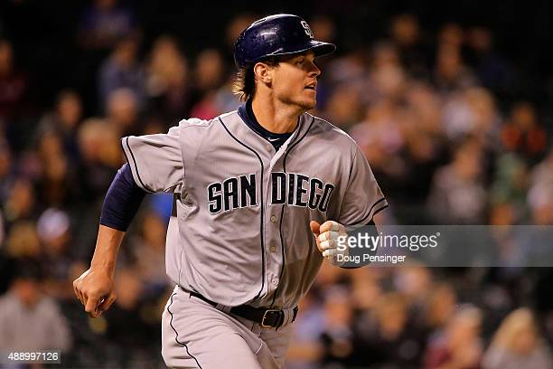 Wil Myers of the San Diego Padres hits a solo home run against the Colorado Rockies at Coors Field on September 18 2015 in Denver Colorado The...