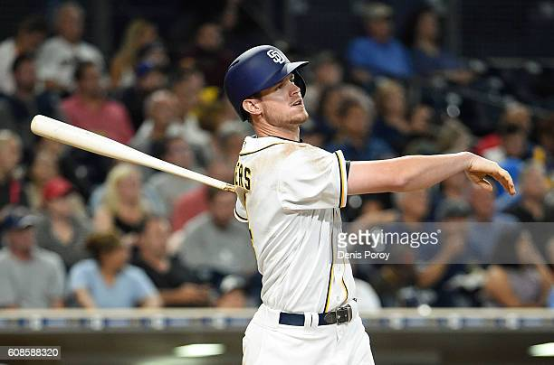 Wil Myers of the San Diego Padres hits a solo home run during the fourth inning of a baseball game against the Arizona Diamondbacks at PETCO Park on...