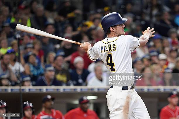 Wil Myers of the San Diego Padres hits an RBI double during the eighth inning of a baseball game against the Washington Nationals at PETCO Park on...
