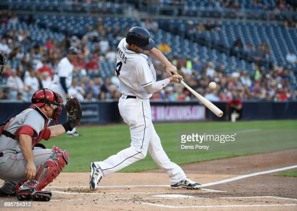 Wil Myers of the San Diego Padres hits an RBI single during the first inning of a baseball game against the Cincinnati Reds at PETCO Park on June 13...