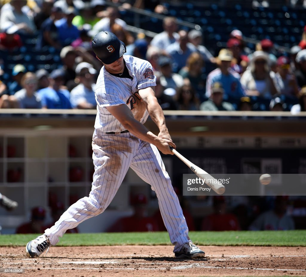 Wil Myers #4 of the San Diego Padres hits an RBI single during the fourth inning of a baseball game against the Philadelphia Phillies at PETCO Park on August 16, 2017 in San Diego, California.
