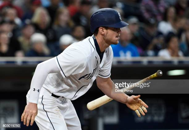 Wil Myers of the San Diego Padres hits an RBI single during the third inning of a baseball game against the Atlanta Braves at PETCO Park on June 28...