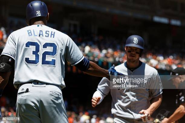 Wil Myers of the San Diego Padres is congratulated by Jabari Blash after hitting a home run against the San Francisco Giants during the fourth inning...