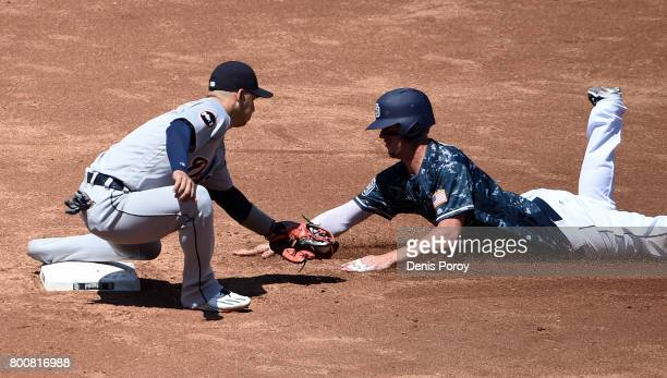Wil Myers of the San Diego Padres is tagged out by Jose Iglesias of the Detroit Tigers as he tries to steals second base during the third inning of a...