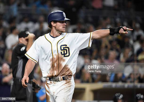 Wil Myers of the San Diego Padres points out to Matt Kemp after scoring during the sixth inning of a baseball game against the New York Yankees at...