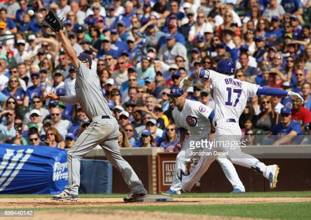 Wil Myers of the San Diego Padres reaches to make a catch to force Kris Bryant of the Chicago Cubs in the 9th inning at Wrigley Field on June 21 2017...