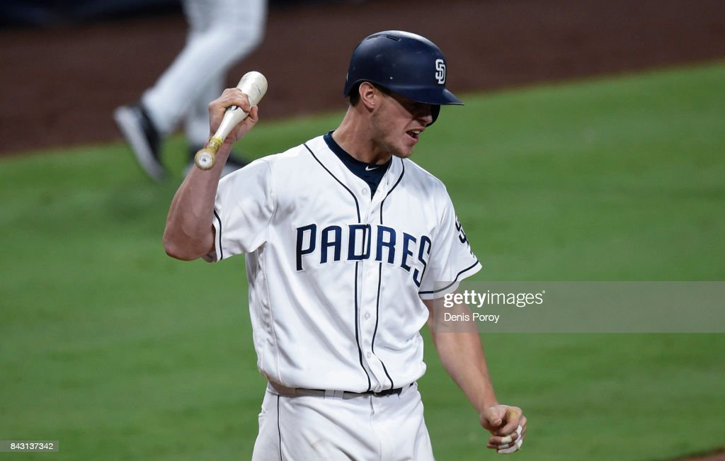 Wil Myers #4 of the San Diego Padres reacts after lining out to third base during the eighth inning of a baseball game against the St. Louis Cardinals at PETCO Park on September 5, 2017 in San Diego, California.