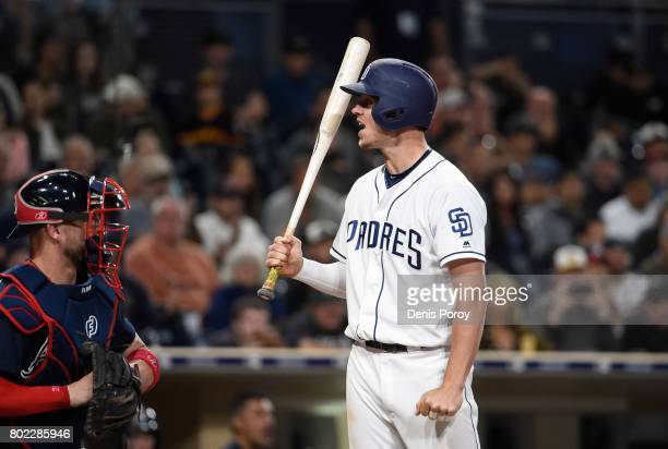Wil Myers of the San Diego Padres reacts to a called strike out as Tyler Flowers of the Atlanta Braves looks on during the eighth inning of a...