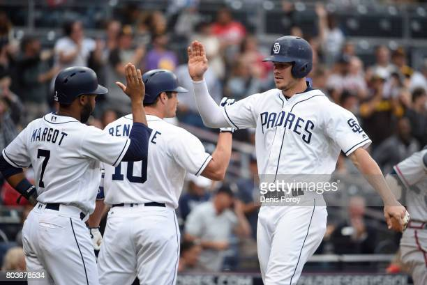 Wil Myers of the San Diego Padres right is congratulated by Hunter Renfroe and Manuel Margot after hitting a tworun home run during the third inning...
