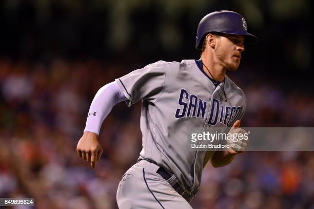Wil Myers of the San Diego Padres runs the bases after hitting a sixth inning solo homerun off of Tyler Chatwood of the Colorado Rockies during a...